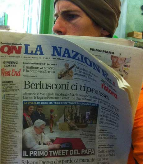 Pic og man reading a news paper