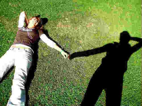 Person holding hands with shadow