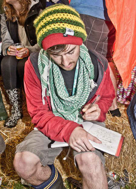 Tom writing at a festival