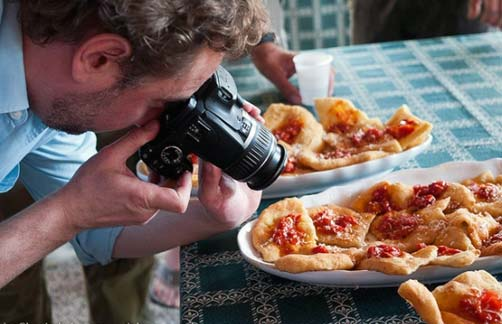 Picture of a man photographing food