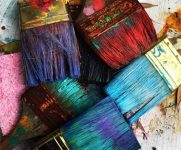 Supporting photo - colourful paint brushes