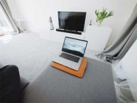 Supporting photo - laptop open on a sofa