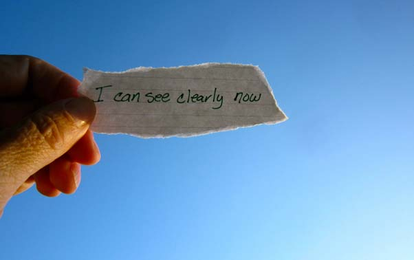 Supporting phote - handwritten note held up to the sky - says i can see clearly now
