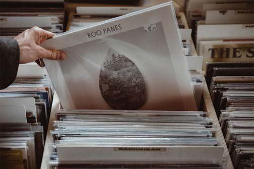 Man pulling record out of record rack