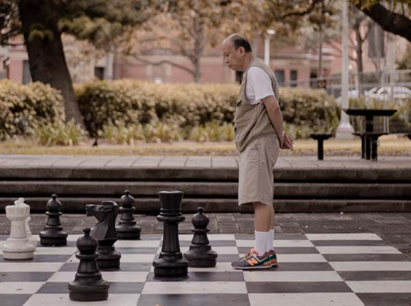 Man on giant chessboard