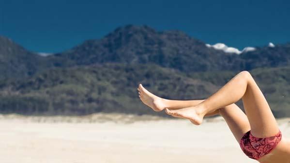 Legs on a beach