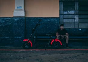 Man by electric scooter