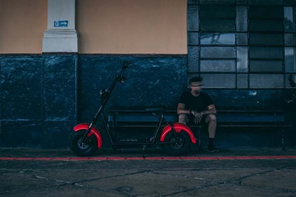 man and electric scooter