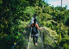 Woman on rope bridge